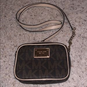 Small MK crossbody, used. Wear shown in pictures